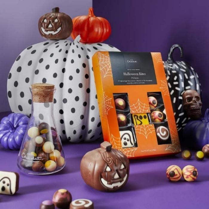 Halloween chocolate treats arranged with painted pumpkins